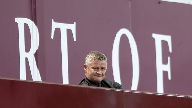 Manchester United's manager Ole Gunnar Solskjaer looks out from the stands during the English Premier League soccer match between Aston Villa and Manchester United at Villa Park in Birmingham, England, Sunday, May 9, 2021. (Nick Potts/Pool via AP)