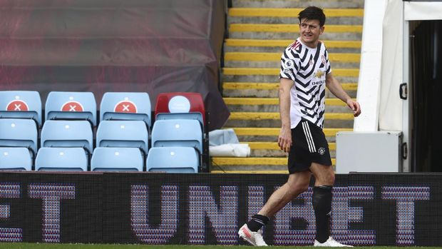 Manchester United's Harry Maguire leaves the field during the English Premier League soccer match between Aston Villa and Manchester United at Villa Park in Birmingham, England, Sunday, May 9, 2021. (Michael Steele/Pool via AP)