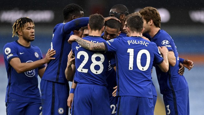 Chelsea players celebrate after scoring their sides first goal during the English Premier League soccer match between Manchester City and Chelsea at the Etihad Stadium in Manchester, Saturday, May 8, 2021.(Shaun Botterill /Pool via AP)