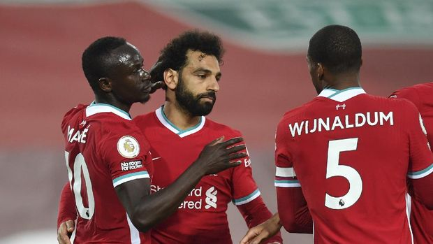 Liverpool's Sadio Mane, left, celebrates with teammates after scoring his side's opening goal during the English Premier League soccer match between Liverpool and Southampton at Anfield stadium in Liverpool, England, Saturday, May 8, 2021. (Paul Ellis/Pool via AP)