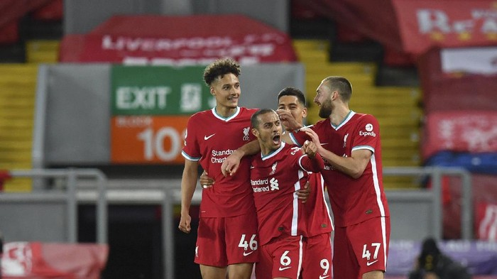 Liverpools Thiago, center, celebrates with teammates after scoring his sides second goal during the English Premier League soccer match between Liverpool and Southampton at Anfield stadium in Liverpool, England, Saturday, May 8, 2021. (Paul Ellis/Pool via AP)