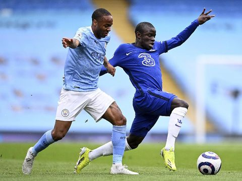 Manchester City's Raheem Sterling, left, and Chelsea's N'Golo Kante challenge for the ball during the English Premier League soccer match between Manchester City and Chelsea at the Etihad Stadium in Manchester, Saturday, May 8, 2021.(Laurence Griffiths/Pool via AP)
