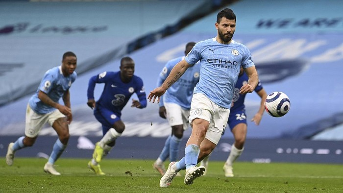 Manchester Citys Sergio Aguero shoots a penalty kick during the English Premier League soccer match between Manchester City and Chelsea at the Etihad Stadium in Manchester, Saturday, May 8, 2021.(Shaun Botterill /Pool via AP)