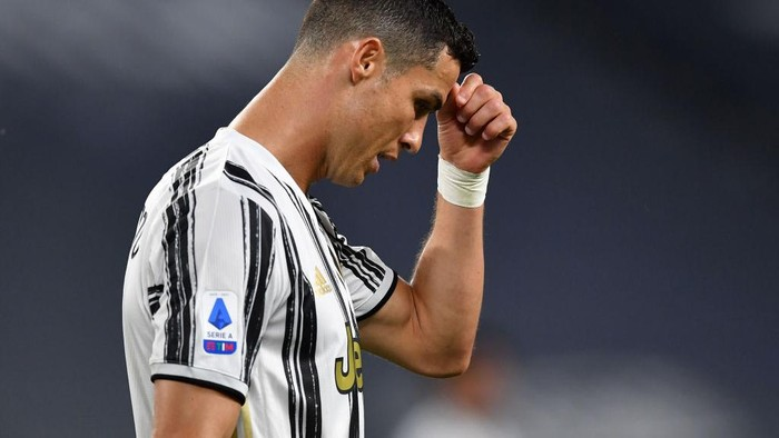 TURIN, ITALY - MAY 09: Cristiano Ronaldo of Juventus looks dejected during the Serie A match between Juventus  and AC Milan at  on May 09, 2021 in Turin, Italy. Sporting stadiums around Italy remain under strict restrictions due to the Coronavirus Pandemic as Government social distancing laws prohibit fans inside venues resulting in games being played behind closed doors. (Photo by Valerio Pennicino/Getty Images)