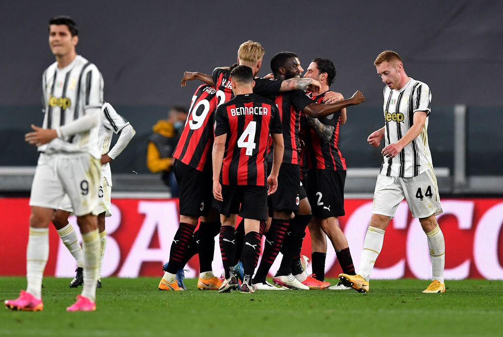 TURIN, ITALY - MAY 09: Ante Rebic of A.C. Milan (hidden) celebrates with team mates after scoring their side's second goal during the Serie A match between Juventus  and AC Milan at  on May 09, 2021 in Turin, Italy. Sporting stadiums around Italy remain under strict restrictions due to the Coronavirus Pandemic as Government social distancing laws prohibit fans inside venues resulting in games being played behind closed doors. (Photo by Valerio Pennicino/Getty Images)