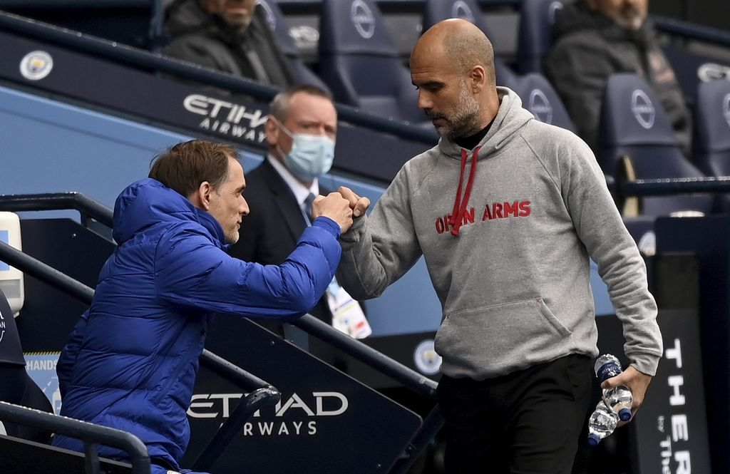 Chelsea's head coach Thomas Tuchel, left, and Manchester City's head coach Pep Guardiola chat before the start of the English Premier League soccer match between Manchester City and Chelsea at the Etihad Stadium in Manchester, Saturday, May 8, 2021.(Shaun Botterill/Pool via AP)