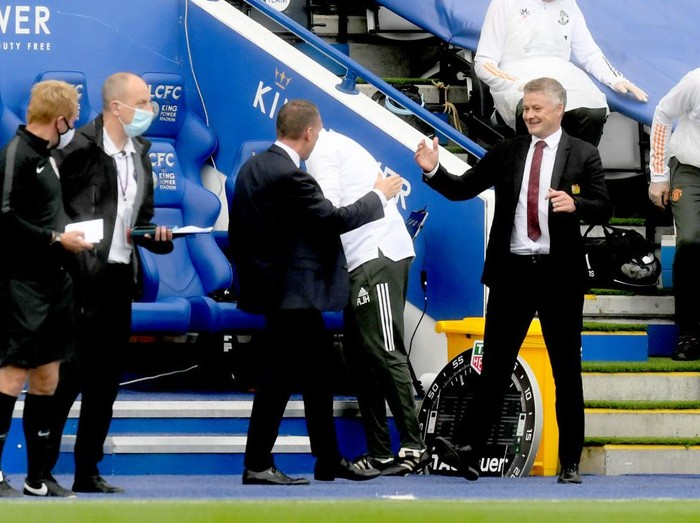 LEICESTER, ENGLAND - JULY 26: Brendan Rodgers, Manager of Leicester City greets Ole Gunnar Solskjaer, Manager of Manchester United prior to the Premier League match between Leicester City and Manchester United at The King Power Stadium on July 26, 2020 in Leicester, England.Football Stadiums around Europe remain empty due to the Coronavirus Pandemic as Government social distancing laws prohibit fans inside venues resulting in all fixtures being played behind closed doors. (Photo by Michael Regan/Getty Images)