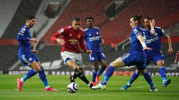 Soccer Football - Premier League - Manchester United v Leicester City - Old Trafford, Manchester, Britain - May 11, 2021 Manchester United's Mason Greenwood in action before scoring their first goal Pool via REUTERS/Dave Thompson EDITORIAL USE ONLY. No use with unauthorized audio, video, data, fixture lists, club/league logos or 'live' services. Online in-match use limited to 75 images, no video emulation. No use in betting, games or single club /league/player publications.  Please contact your account representative for further details.