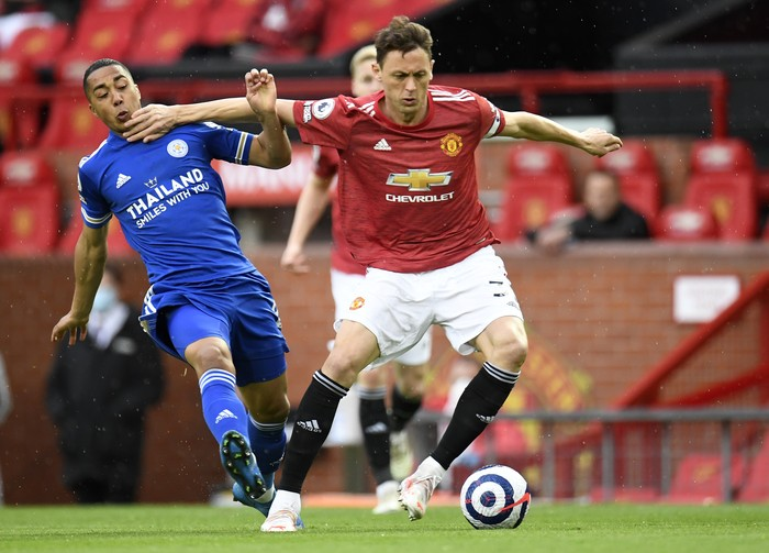 Manchester Uniteds Nemanja Matic, right, duels for the ball with Leicesters Youri Tielemans during the English Premier League soccer match between Manchester United and Leicester City, at the Old Trafford stadium in Manchester, England, Tuesday, May 11, 2021. (Peter Powell/Pool via AP)