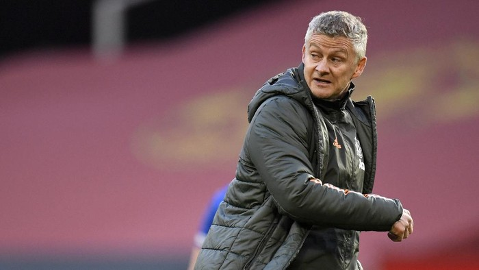 Manchester Uniteds manager Ole Gunnar Solskjaer leaves the field after the English Premier League soccer match between Manchester United and Leicester City, at the Old Trafford stadium in Manchester, England, Tuesday, May 11, 2021. (Peter Powell/Pool via AP)