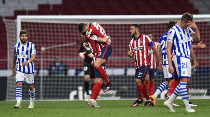 MADRID, SPAIN - MAY 12: Mario Hermoso of Atletico Madrid celebrates with a team mate during the La Liga Santander match between Atletico de Madrid and Real Sociedad at Estadio Wanda Metropolitano on May 12, 2021 in Madrid, Spain. Sporting stadiums around Spain remain under strict restrictions due to the Coronavirus Pandemic as Government social distancing laws prohibit fans inside venues resulting in games being played behind closed doors. (Photo by Denis Doyle/Getty Images)