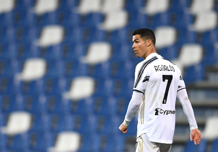 REGGIO NELLEMILIA, ITALY - MAY 12: Cristiano Ronaldo of Juventus looks on during the Serie A match between US Sassuolo and Juventus at Mapei Stadium - Città del Tricolore on May 12, 2021 in Reggio nellEmilia, Italy. Sporting stadiums around Italy remain under strict restrictions due to the Coronavirus Pandemic as Government social distancing laws prohibit fans inside venues resulting in games being played behind closed doors.  (Photo by Alessandro Sabattini/Getty Images)
