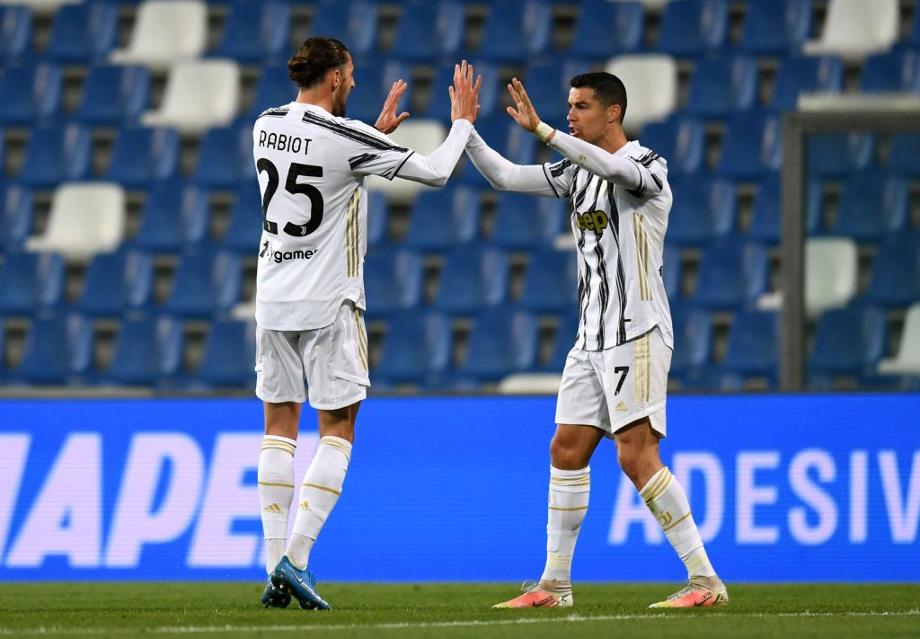 REGGIO NELL'EMILIA, ITALY - MAY 12: Adrien Rabiot of Juventus celebrates with Cristiano Ronaldo after scoring their side's first goal during the Serie A match between US Sassuolo and Juventus at Mapei Stadium - Città del Tricolore on May 12, 2021 in Reggio nell'Emilia, Italy. Sporting stadiums around Italy remain under strict restrictions due to the Coronavirus Pandemic as Government social distancing laws prohibit fans inside venues resulting in games being played behind closed doors.  (Photo by Alessandro Sabattini/Getty Images)