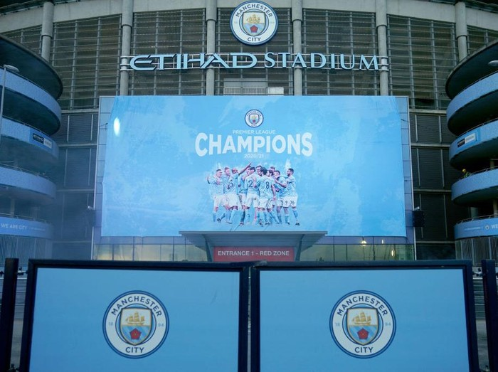 MANCHESTER, ENGLAND - MAY 11: A large display outside Etihad Stadium reads Champions as Manchester City has been confirmed as Premier League champions for the third time in four seasons on May 11, 2021 in Manchester, England. Manchester City Football club claims the Premier League title as nearest rival Manchester United lost to Leicester today 1-2. Football fans are currently unable to attend matches due to coronavirus restrictions. (Photo by Christopher Furlong/Getty Images)