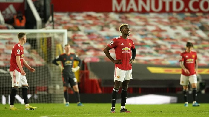 MANCHESTER, ENGLAND - MAY 13: Paul Pogba of Manchester United looks dejected after conceding a fourth goal scored by Mohamed Salah of Liverpool (not pictured) during the Premier League match between Manchester United and Liverpool at Old Trafford on May 13, 2021 in Manchester, England. Sporting stadiums around the UK remain under strict restrictions due to the Coronavirus Pandemic as Government social distancing laws prohibit fans inside venues resulting in games being played behind closed doors. (Photo by Dave Thompson - Pool/Getty Images)