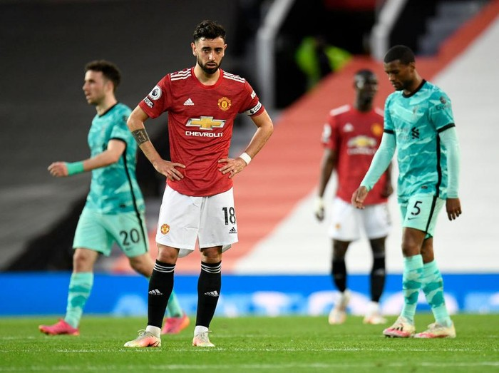 MANCHESTER, ENGLAND - MAY 13: Bruno Fernandes of Manchester United looks dejected after conceding a second goal scored by Roberto Firmino of Liverpool (not pictured) during the Premier League match between Manchester United and Liverpool at Old Trafford on May 13, 2021 in Manchester, England. Sporting stadiums around the UK remain under strict restrictions due to the Coronavirus Pandemic as Government social distancing laws prohibit fans inside venues resulting in games being played behind closed doors. (Photo by Peter Powell - Pool/Getty Images)