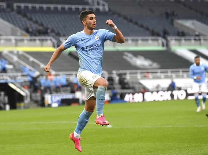 Manchester Citys Ferran Torres celebrates after scoring his sides second goal during the English Premier League soccer match between Newcastle United and Manchester City at St James Park stadium, in Newcastle, England, Friday, May 14, 2021. (Stu Forster/Pool via AP)