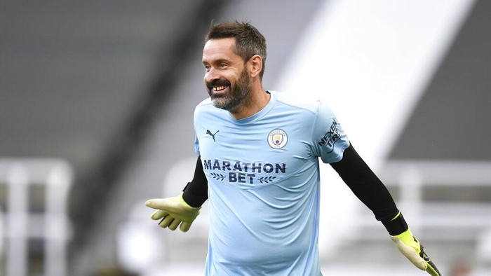 Manchester Citys goalkeeper Scott Carson warms up prior to the English Premier League soccer match between Newcastle United and Manchester City at St James Park stadium, in Newcastle, England, Friday, May 14, 2021. (Peter Powell/Pool via AP)