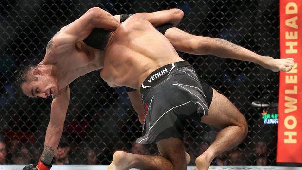 May 15, 2021; Houston, Texas, USA; Beneil Dariush brings down Tony Ferguson during UFC 262 at Toyota Center. Mandatory Credit: Troy Taormina-USA TODAY Sports