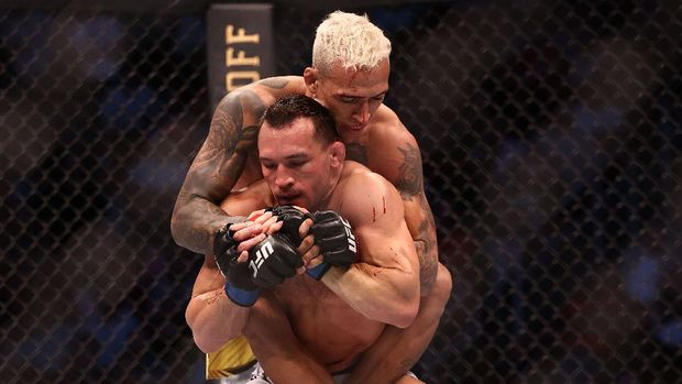May 15, 2021; Houston, Texas, USA; Charles Oliveira applies a hold against Michael Chandler uring UFC 262 at Toyota Center. Mandatory Credit: Troy Taormina-USA TODAY Sports
