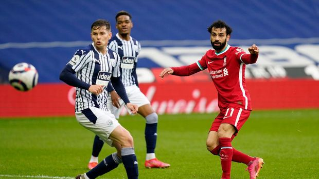 WEST BROMWICH, ENGLAND - MAY 16: Mohamed Salah of Liverpool scores their team's first goal during the Premier League match between West Bromwich Albion and Liverpool at The Hawthorns on May 16, 2021 in West Bromwich, England. Sporting stadiums around the UK remain under strict restrictions due to the Coronavirus Pandemic as Government social distancing laws prohibit fans inside venues resulting in games being played behind closed doors. (Photo by Tim Keeton - Pool/Getty Images)