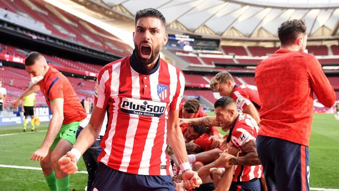 MADRID, SPAIN - MAY 16: Yannick Ferreira Carrasco of Atletico Madrid celebrates Atletico de Madrids second goal scored by Luis Suarez (not pictured)  during the La Liga Santander match between Atletico de Madrid and C.A. Osasuna at Estadio Wanda Metropolitano on May 16, 2021 in Madrid, Spain. Sporting stadiums around Spain remain under strict restrictions due to the Coronavirus Pandemic as Government social distancing laws prohibit fans inside venues resulting in games being played behind closed doors.  (Photo by Denis Doyle/Getty Images)