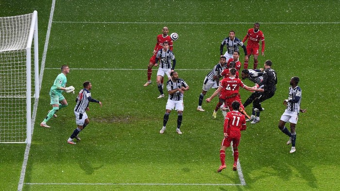 WEST BROMWICH, ENGLAND - MAY 16: Alisson of Liverpool scores their sides second goal past Sam Johnstone of West Bromwich Albion during the Premier League match between West Bromwich Albion and Liverpool at The Hawthorns on May 16, 2021 in West Bromwich, England. Sporting stadiums around the UK remain under strict restrictions due to the Coronavirus Pandemic as Government social distancing laws prohibit fans inside venues resulting in games being played behind closed doors. (Photo by Laurence Griffiths/Getty Images)