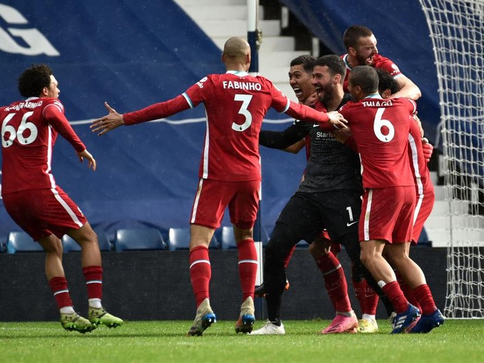 WEST BROMWICH, ENGLAND - MAY 16: Alisson of Liverpool celebrates with team mates after scoring their sides second goal during the Premier League match between West Bromwich Albion and Liverpool at The Hawthorns on May 16, 2021 in West Bromwich, England. Sporting stadiums around the UK remain under strict restrictions due to the Coronavirus Pandemic as Government social distancing laws prohibit fans inside venues resulting in games being played behind closed doors. (Photo by Rui Vieira - Pool/Getty Images)