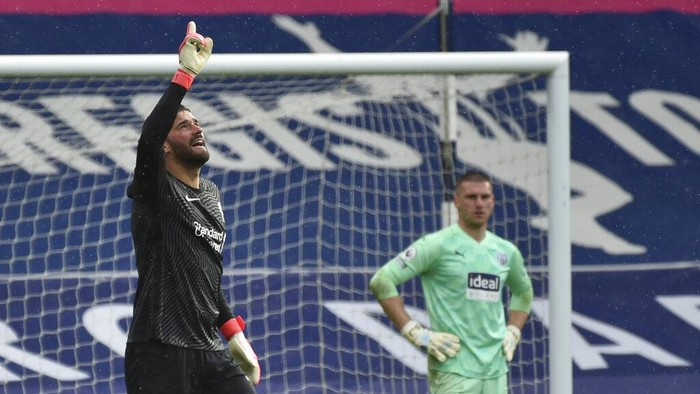 Liverpools goalkeeper Alisson celebrates after scoring his sides second goal during the English Premier League soccer match between West Bromwich Albion and Liverpool at the Hawthorns stadium in West Bromwich, England, Sunday, May 16, 2021. (AP Photo/Rui Vieira,Pool)