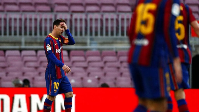 Barcelonas Lionel Messi reacts during the Spanish La Liga soccer match between FC Barcelona and Celta at the Camp Nou stadium in Barcelona, Spain, Sunday, May. 16, 2021. (AP Photo/Joan Monfort)