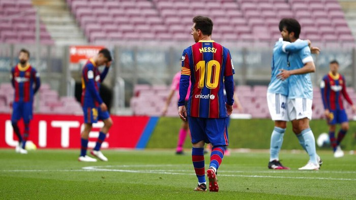 Barcelonas Lionel Messi walks as Celta players celebrate scoring their sides first goal during the Spanish La Liga soccer match between FC Barcelona and Celta at the Camp Nou stadium in Barcelona, Spain, Sunday, May. 16, 2021. (AP Photo/Joan Monfort)