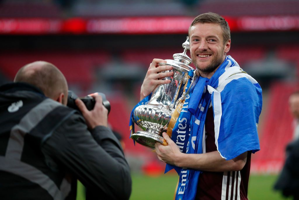 LONDON, ENGLAND - MAY 15: Jamie Vardy of Leicester City celebrates with the Emirates FA Cup trophy following The Emirates FA Cup Final match between Chelsea and Leicester City at Wembley Stadium on May 15, 2021 in London, England. A limited number of around 21,000 fans, subject to a negative lateral flow test, will be allowed inside Wembley Stadium to watch this year's FA Cup Final as part of a pilot event to trial the return of large crowds to UK venues. (Photo by Matt Childs - Pool/Getty Images)
