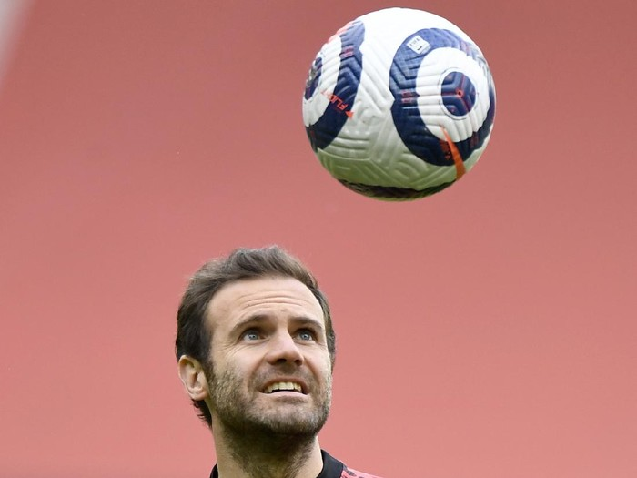 Manchester Uniteds Juan Mata heads the ball during warm up before the English Premier League soccer match between Manchester United and Leicester City, at the Old Trafford stadium in Manchester, England, Tuesday, May 11, 2021. (Peter Powell/Pool via AP)