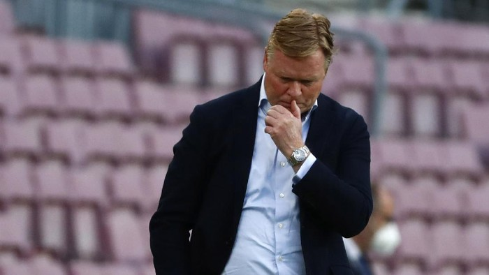 Barcelonas head coach Ronald Koeman reacts as he watches the game during the Spanish La Liga soccer match between FC Barcelona and Celta at the Camp Nou stadium in Barcelona, Spain, Sunday, May. 16, 2021. (AP Photo/Joan Monfort)
