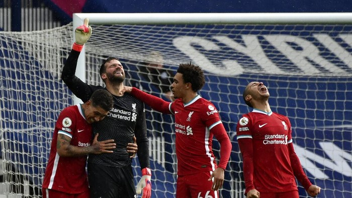 Liverpools goalkeeper Alisson, second left, celebrates with teammates after scoring his sides second goal during the English Premier League soccer match between West Bromwich Albion and Liverpool at the Hawthorns stadium in West Bromwich, England, Sunday, May 16, 2021. (AP Photo/Rui Vieira,Pool)