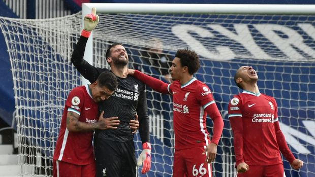 Soccer Football - Premier League - West Bromwich Albion v Liverpool - The Hawthorns, West Bromwich, Britain - May 16, 2021 Liverpool's Alisson celebrates scoring their second goal with Roberto Firmino and Trent Alexander-Arnold Pool via REUTERS/Rui Vieira EDITORIAL USE ONLY. No use with unauthorized audio, video, data, fixture lists, club/league logos or 'live' services. Online in-match use limited to 75 images, no video emulation. No use in betting, games or single club /league/player publications.  Please contact your account representative for further details.