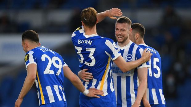 BRIGHTON, ENGLAND - MAY 18: Dan Burn of Brighton and Hove Albion celebrates with Adam Webster after scoring their side's third goal during the Premier League match between Brighton & Hove Albion and Manchester City at American Express Community Stadium on May 18, 2021 in Brighton, England. A limited number of fans will be allowed into Premier League stadiums as Coronavirus restrictions begin to ease in the UK following the COVID-19 pandemic. (Photo by Mike Hewitt/Getty Images)