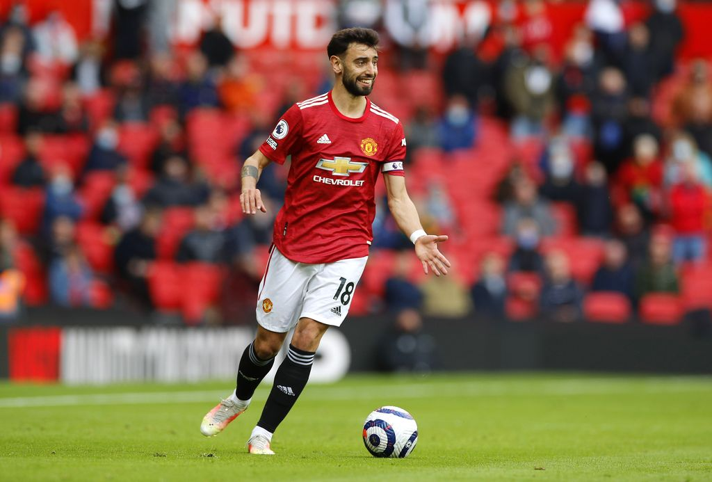 MANCHESTER, ENGLAND - MAY 18: Bruno Fernandes of Manchester United runs with the ball during the Premier League match between Manchester United and Fulham at Old Trafford on May 18, 2021 in Manchester, England. A limited number of fans will be allowed into Premier League stadiums as Coronavirus restrictions begin to ease in the UK following the COVID-19 pandemic. (Photo by Phil Noble - Pool/Getty Images)
