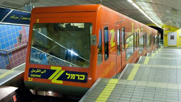 Haifa, Israel - January 20, 2014: Gan Ha'em Carmelit underground train station with people, in Haifa Israel. Shortest underground train line in the world.