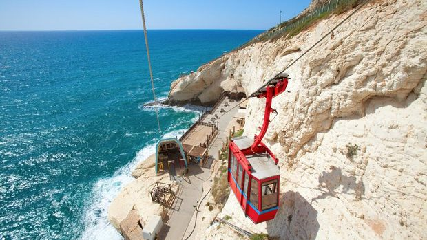 Beautiful view on the red cable car with the cliffs of Rosh Hanikra