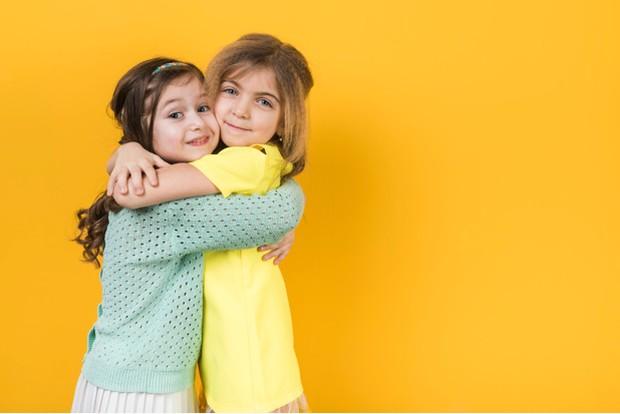 Two Girls Hugging   Freepik.com