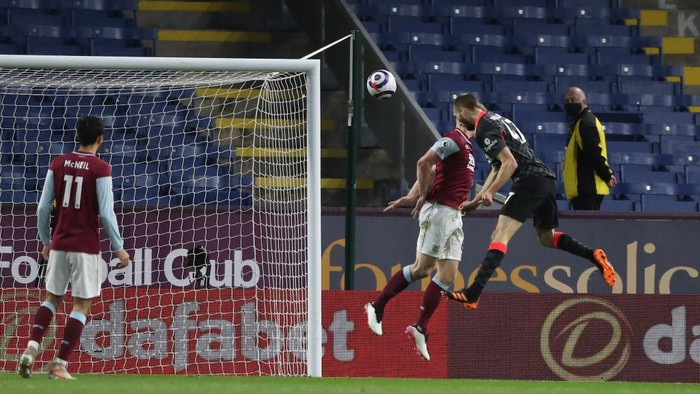 BURNLEY, ENGLAND - MAY 19: Nathaniel Phillips of Liverpool scores their sides second goal during the Premier League match between Burnley and Liverpool at Turf Moor on May 19, 2021 in Burnley, England. A limited number of fans will be allowed into Premier League stadiums as Coronavirus restrictions begin to ease in the UK. (Photo by Martin Rickett - Pool/Getty Images)