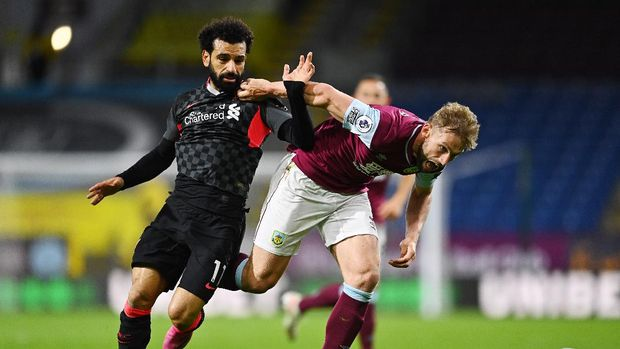 Soccer Football - Premier League - Burnley v Liverpool - Turf Moor, Burnley, Britain - May 19, 2021 Liverpool's Mohamed Salah in action with Burnley's Charlie Taylor Pool via REUTERS/Clive Mason EDITORIAL USE ONLY. No use with unauthorized audio, video, data, fixture lists, club/league logos or 'live' services. Online in-match use limited to 75 images, no video emulation. No use in betting, games or single club /league/player publications.  Please contact your account representative for further details.