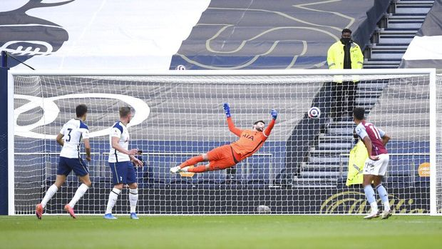 Tottenham's Sergio Reguilon, left, scores an own goal past his goalkeeper during the English Premier League soccer match between Tottenham Hotspur and Aston Villa at the Tottenham Hotspur Stadium in London, Wednesday, May 19, 2021. (Daniel Leal-Olivas/Pool via AP)
