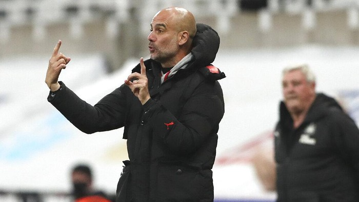 Manchester Citys head coach Pep Guardiola gives instructions from the side line during the English Premier League soccer match between Newcastle United and Manchester City at St James Park stadium, in Newcastle, England, Friday, May 14, 2021. (AP Photo/Scott Heppell, Pool)