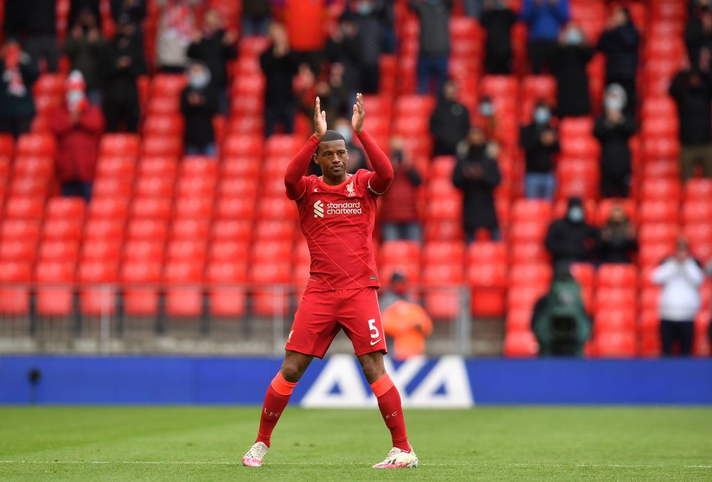 LIVERPOOL, ENGLAND - MAY 23: Georginio Wijnaldum of Liverpool applauds the fans as he is substituted during the Premier League match between Liverpool and Crystal Palace at Anfield on May 23, 2021 in Liverpool, England. A limited number of fans will be allowed into Premier League stadiums as Coronavirus restrictions begin to ease in the UK. (Photo by Paul Ellis - Pool/Getty Images)