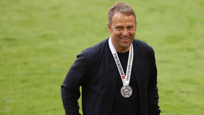 MUNICH, GERMANY - MAY 22: Hans-Dieter Flick, Head coach of FC Bayern Muenchen smiles after the Bundesliga match between FC Bayern Muenchen and FC Augsburg at Allianz Arena on May 22, 2021 in Munich, Germany. After the Bavarian cabinet decided on first relaxations for outdoor events, the current Corona situation allows FC Bayern to have its last match of the season in front of 250 spectators in the Allianz Arena. Of these, 100 tickets are given to people from the health sector selected by the Ministry of Health. (Photo by Alexander Hassenstein/Getty Images)