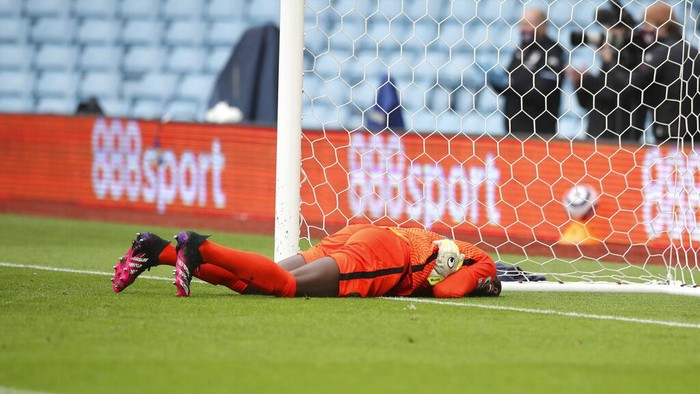 Chelseas goalkeeper Edouard Mendy lies on the pitch during the English Premier League soccer match between Aston Villa and Chelsea, at Villa Park stadium in Birmingham England, Sunday, May 23, 2021. (Nick Potts, Pool via AP)