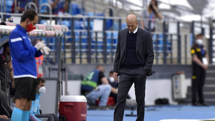 Real Madrids head coach Zinedine Zidane walks by the touchline during the Spanish La Liga last round soccer match between Real Madrid and Villarreal at the Alfredo Di Stefano stadium in Madrid, Saturday, May 22, 2021. (AP Photo/Pablo Morano)