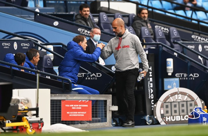 MANCHESTER, ENGLAND - MAY 08: Pep Guardiola (R), Manager of Manchester City greets Thomas Tuchel, Manager of Chelsea prior to the Premier League match between Manchester City and Chelsea at Etihad Stadium on May 08, 2021 in Manchester, England. Sporting stadiums around the UK remain under strict restrictions due to the Coronavirus Pandemic as Government social distancing laws prohibit fans inside venues resulting in games being played behind closed doors. (Photo by Shaun Botterill/Getty Images)